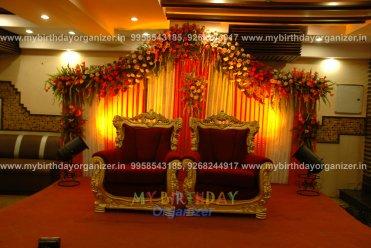 flower decoration stage image, flower decoration stage in wedding, flower decoration in stage, flower arrangement in stage,flower decoration for wedding stage jaipur, flower stage decoration for marriage.