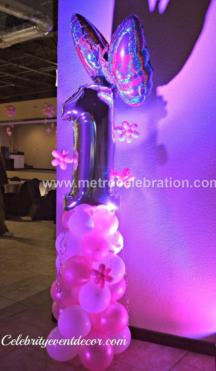 First birthday party decoration ideas -1st birthday column with balloons twisting work on foil balloons