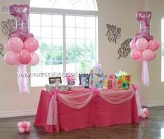 Cake table decor - Pink polka dot , balloons bunches with frills decoration